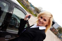 smiling blonde with car keys - stock photo