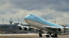 Huge 747 jumbo jet take off Stock Footage