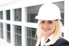 Stock Photo of portrait of woman with construction helmet