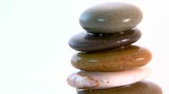 Track onto wet zen stones Stock Footage