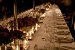 Elegant candlelight  dinner table setting at reception Stock Photos