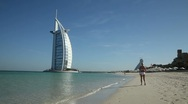 Stock Video Footage of Walking on Jumeirah Beach towards the Burj Al Arab hotel, Dubai