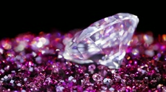 Big jewel stone with many violet small one rotating Stock Footage