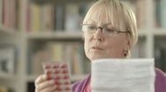 Senior woman with medication pills and prescription Stock Footage