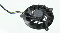Black computer fan spinning up and down on white Stock Footage