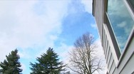 Stock Video Footage of House Windows and Clouds Time Lapse