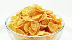 Corn flakes heap in a glass bowl rotating Stock Footage