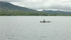 Fisherman on lake in Bali Stock Footage