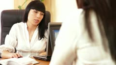 Two Young Women Discussing Business Issues Stock Footage