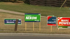 Politics, election signs and traffic Stock Footage