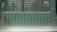 Heavy rain at a Chinese bus station Stock Footage