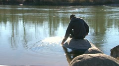 Person at River Setting 3 Stock Footage