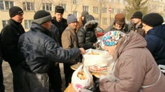 Distribution of hot meals to homeless persons, Russia Stock Footage