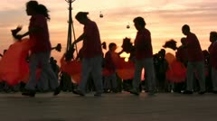 Senior Chinese women perform traditional Chinese dance at sunset Stock Footage