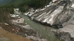 Avalanche debris, river and mountain, early spring Stock Footage
