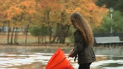 Girl with an umbrella - stock footage