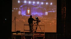 523 Professional Camera man shooting a public ceremony Stock Footage