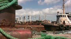 Rusty old fishing boats at wharf in China Stock Footage