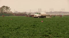 Water tender watering fields california water drought immigration farming jobs   Stock Footage