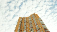 Red/orange building with cloud reflections. Stock Footage