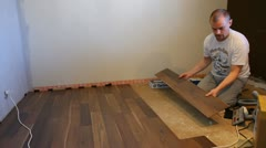 Installing laminate flooring Stock Footage