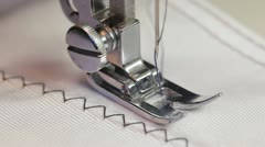 Sewing machine and item of clothing Stock Footage
