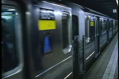 A New York City Subway Train leaves  68th and Lexington Avenue Stock Footage