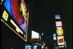 Times Square, New York City at night, view up Broadway, taxis, circa 1995 - stock footage