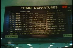 "Penn Station, New York City, Departure board, zoom in to ""Broadway Limited"" - stock footage"