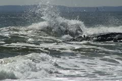 Waves breaking on rock Stock Footage