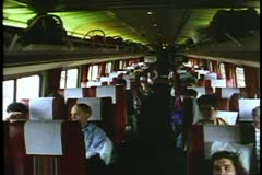 "Amtrak's ""Broadway Limited"" Interior of a coach car, passengers seated Stock Footage"