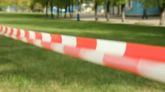 Fenced area. Restrictive tape to vegetation (lawn) Stock Footage