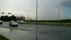 Low faint rainbow traffic cars rain poodle water Stock Footage