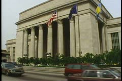 Philadelphia's 30th Street Station, neoclassic facade, cars & cabs, busy - stock footage