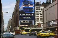 Seventh Avenue in New York, taxis, big Metroliner sign near Penn Station Stock Footage