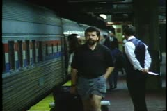 Pennsylvania Station, New York City, man in shorts walks alongside train Stock Footage