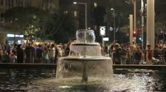 522 city fountain and out of focused crowd at night Stock Footage