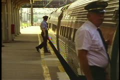 "Conductor checks platform and boards Amtrak's ""Broadway Limited"" Stock Footage"