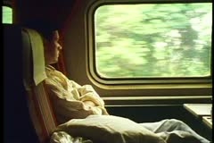 "Amtrak's ""Broadway Limited"", young man in coach watching passing scenery - stock footage"