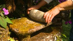 History & culture, Barriles culture milling stone and woman's hands Stock Footage