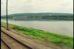 "Amtrak's ""Broadway Limited"", POV from train retreating, Susquehanna River Stock Footage"