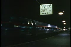 "Amtrak's ""Broadway Limited"" departs Penn Station, Pittsburgh at night - stock footage"