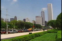 The Chicago skyline, Prudential Building, parkland, cars Stock Footage