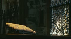 Man walks past candles in Roman church (slow motion) Stock Footage