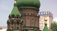 Stock Video Footage of Contrast - Chinese advertising behind Russian church in Harbin