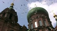 Stock Video Footage of Flying pigeons in front of St. Sophia church, Harbin / China