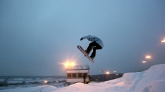 Snowboarder jumping from a springboard Stock Footage