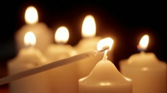 Lighting votive candle - stock footage