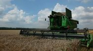 Large harvester passes by and stops Stock Footage