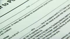 Tilt up purchase document Stock Footage